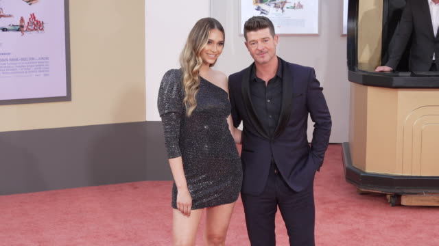 "april love geary and robin thicke at the ""once upon a time in hollywood"" premiere at tcl chinese theatre on july 22, 2019 in hollywood, california. - aprile video stock e b–roll"