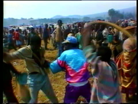 April Rwandan Massacre begins in 1994 The Rwanda Collection G Rwanda massacre refugees arriving in camp / UN and African soldiers trying to control...