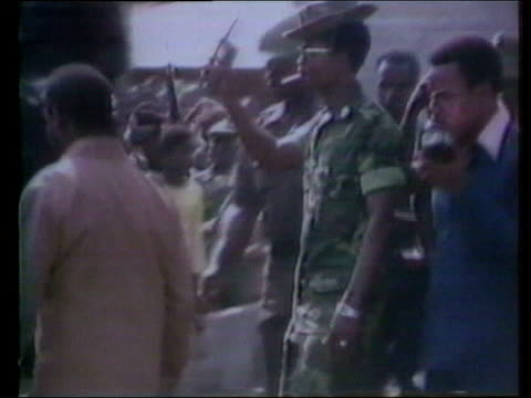 april samuel doe takes control of liberia in a coup dã©tat ext/int samuel doe along after coup in 1980 / soldiers marching / charles taylor along... - 1980 stock videos & royalty-free footage