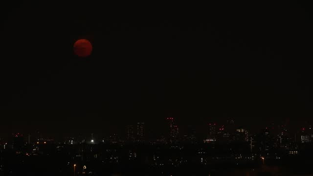 april's pink superman rises over a cloudy london skyline as seen from alexandra palace on april 27, 2021 in london, england. the rare phenomenon... - moon stock videos & royalty-free footage
