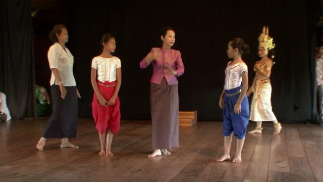 MS Apsara instructor teaching younger dancers / Phnom Penh, Cambodia