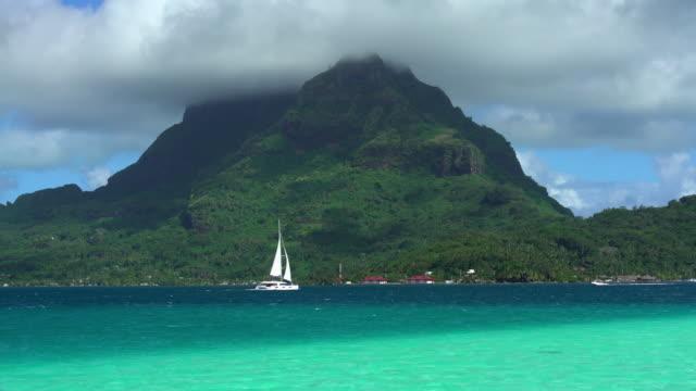 aquamarine lagoon sail boat mt otemanu bora bora - polynesian ethnicity stock videos & royalty-free footage
