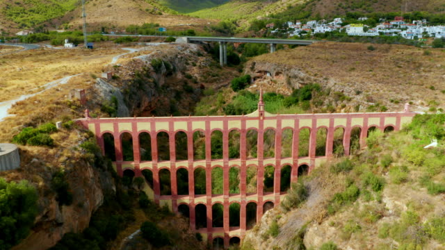 aqueduct eagle, nerja, andalusia, spain - brick house stock videos & royalty-free footage