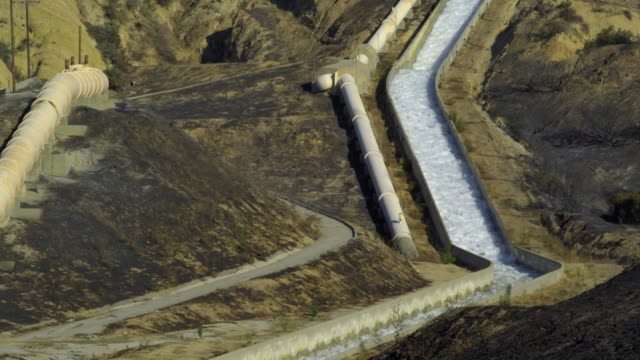 MS, Aqueduct in mountain landscape, Sylmar, California, USA
