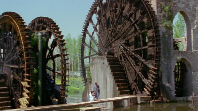 ws, pan, aqueduct with water wheels, hama, syria - water wheel stock videos and b-roll footage