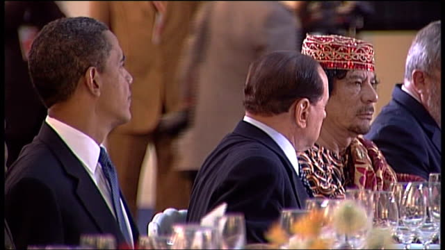 ext colonel muammar gaddafi waving to press as arriving at g8 summit italian prime minister silvio berlusconi nicolas sarkozy dmitri medvedev barack... - bodyguard stock videos & royalty-free footage