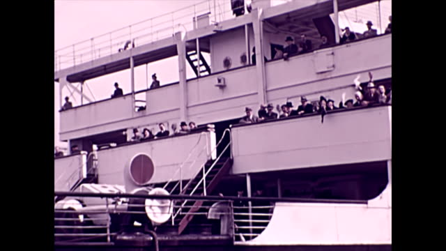 rms aquitania departs from the dock / crowds wave from the deck and take photographs / cu of the ship's name as it passes by camera - 1937 stock videos & royalty-free footage