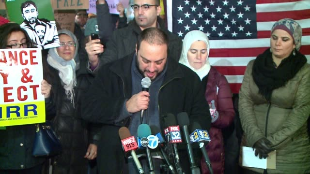 arab american action network executive director hatem abudayyeh speaks at protest against trump's immigration order at o'hare airport in chicago on... - executive director stock videos & royalty-free footage