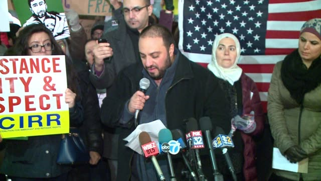 wgn arab american action network executive director hatem abudayyeh speaks at protest against trump's immigration order at o'hare airport in chicago... - executive director stock videos & royalty-free footage