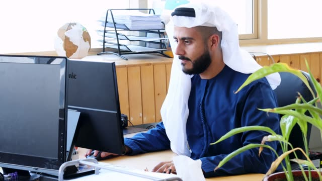 arab business executive working at an office - working stock videos & royalty-free footage
