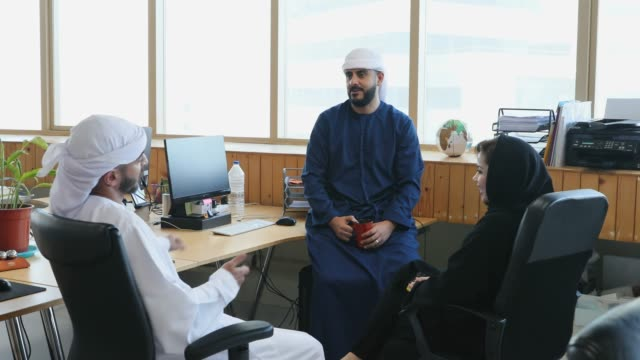 arab business executives having group discussion around office cubical - businessman stock videos & royalty-free footage