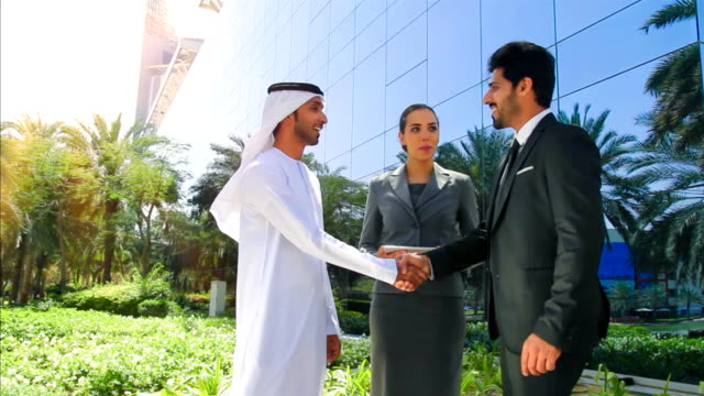 arab business people shaking hands - dish dash stock videos & royalty-free footage