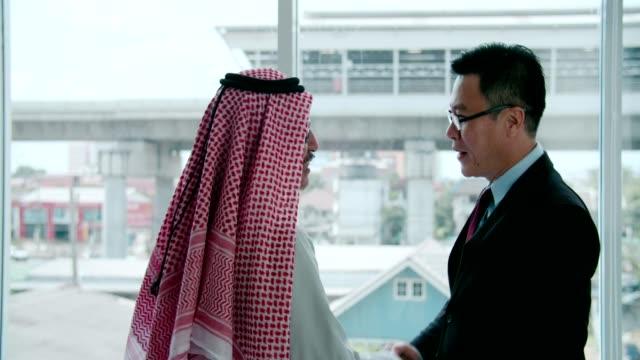 arab businessman congratulating - financial occupation stock videos & royalty-free footage