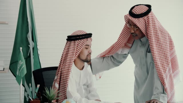 arab businessman talking in office - comforting colleague stock videos & royalty-free footage