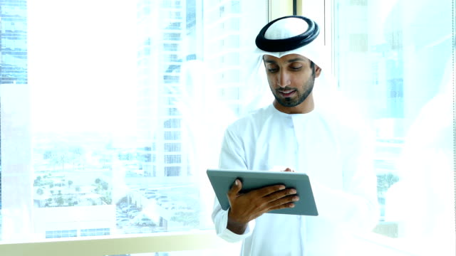 arab businessman using digital tablet in the office - success stock videos & royalty-free footage