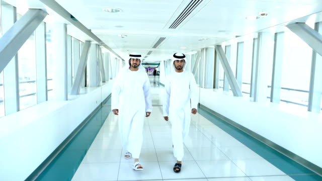 Arab businessmen in traditional clothes - Dubai Subway Station