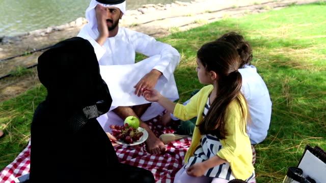 Arab family enjoying their leisure time in picnic