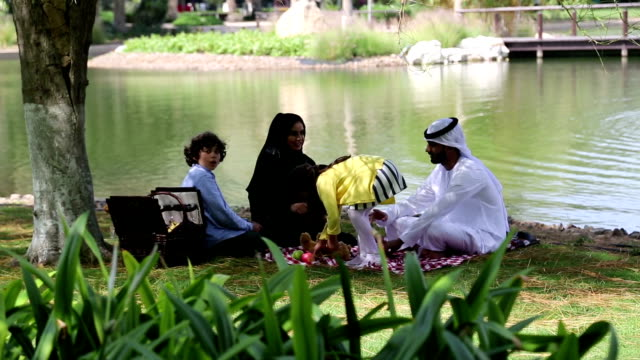 Arab family enjoying their leisure time in picnic