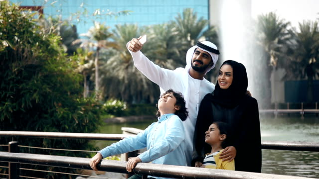 arab family taking selfie outdoors - middle eastern ethnicity stock videos & royalty-free footage