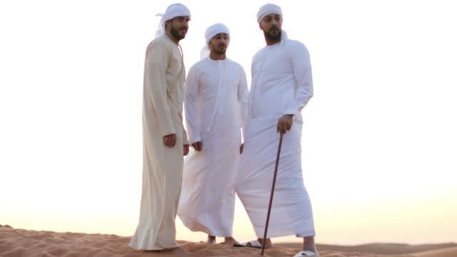 Arab Friends Having Casual Conversation during their Desert Visit