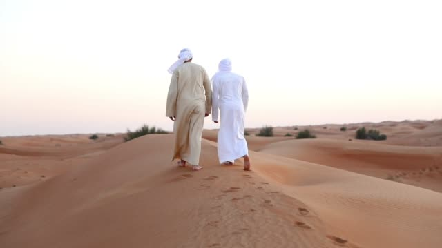 arab friends out of dubai desert for a weekend - only men stock videos & royalty-free footage