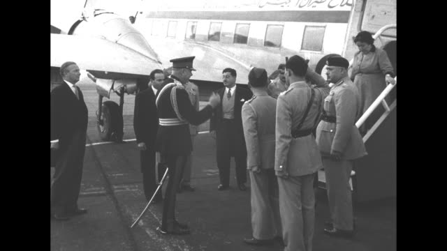 arab legion air force dc-3 plane on tarmac / in military uniform, king hussein of jordan walks down steps followed by queen dina; they are greeted by... - army stock videos & royalty-free footage