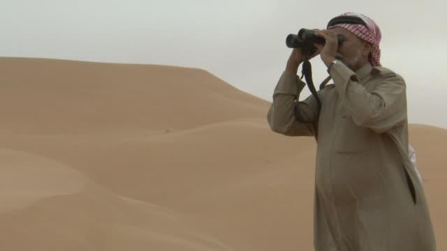 ms arab man looking through his binoculars / najran city, najran, saudi arabia  - looking through an object stock videos & royalty-free footage