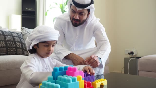 arab man playing with his son at home - father stock videos & royalty-free footage