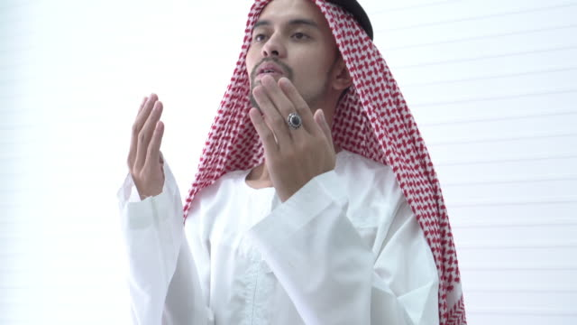 arab man pray - praying stock videos & royalty-free footage
