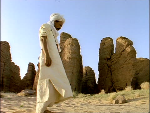 MS Arab man standing up from worship position, beginning Salah (ritual prayer), Algeria, Africa