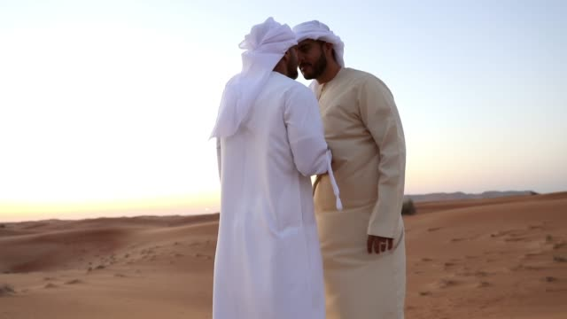 arab men greetings in the desert - cultures stock videos & royalty-free footage