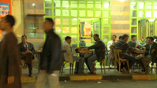 ms arab men sitting outside cafe / hurghada, red sea coast, egypt - north africa stock videos & royalty-free footage