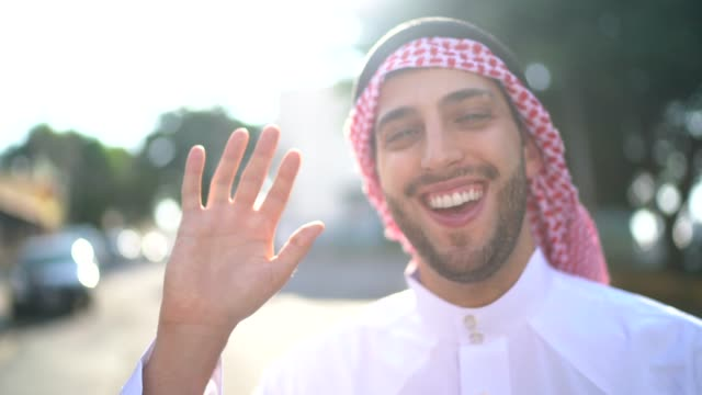 arab middle east doing a video call at street - traditional clothing stock videos & royalty-free footage