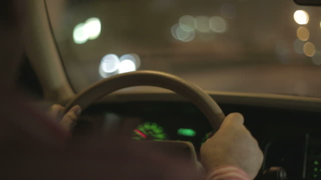 arab taxi driver. over-the-shoulder a taxi driver driving on the streets by night. city lights and traffic are reflected in the car's windscreen. - car stock videos & royalty-free footage