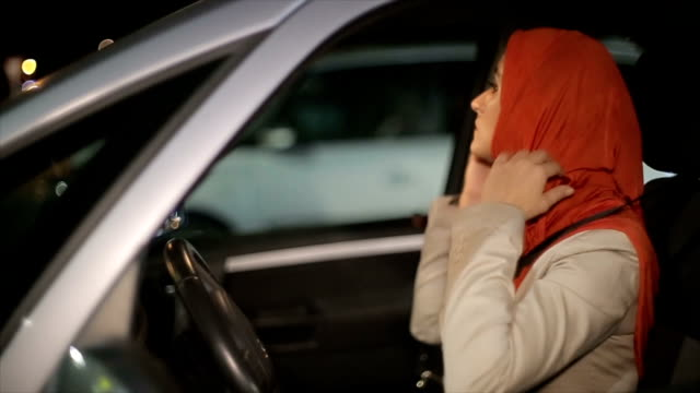 A Arab woman in the car