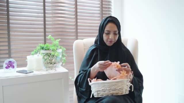 arab woman preparing gift bags - collection stock videos & royalty-free footage