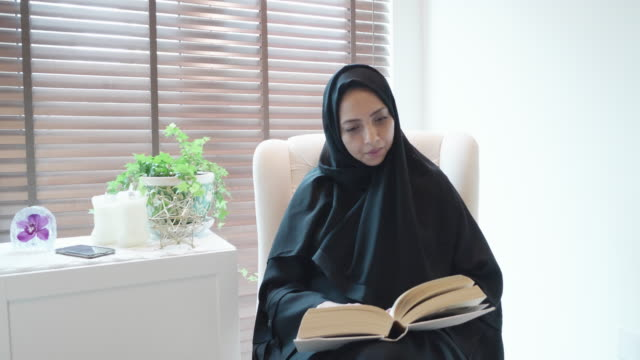 arab woman reading a book in the home study - detox stock videos & royalty-free footage