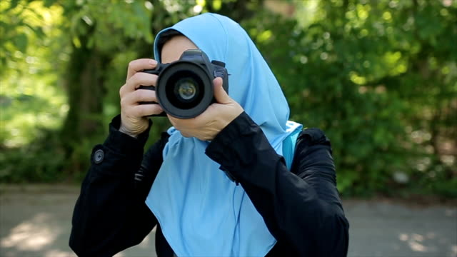 a arab woman takes a photo of her friend,pov - oman stock videos & royalty-free footage