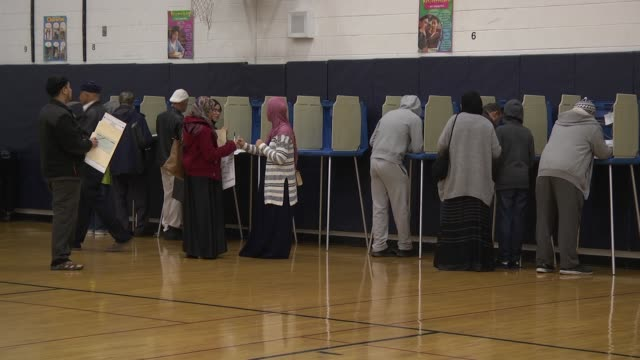 arab_american voters stand at voting booths to cast their ballots in the 218 midterm election - midterm election stock videos & royalty-free footage