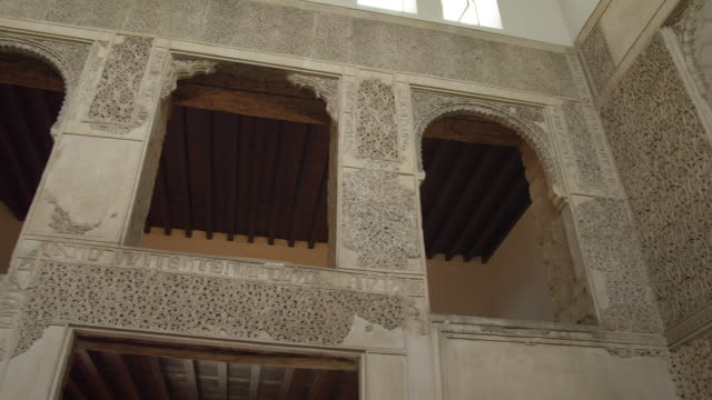 la pan arabesque stone carvings in synagogue starting at three arches of elevated women's gallery - temple building stock videos and b-roll footage