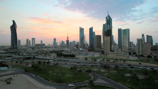 arabian peninsula, kuwait, kuwait city, elevated dusk view over the modern city centre architecture - kuwait stock videos and b-roll footage