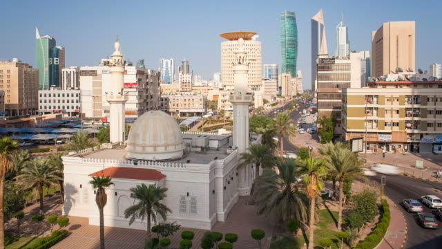 Arabian Peninsula, Kuwait, Kuwait City, time lapse of the modern city centre architecture and traditional mosque