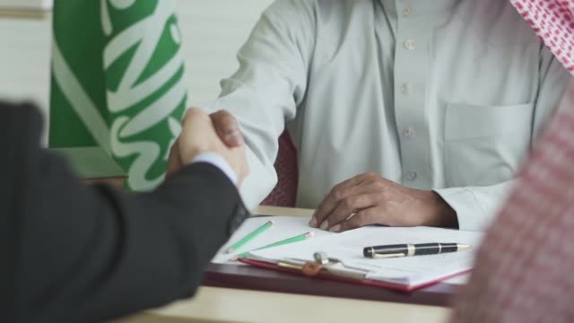 arabic businessman shaking hand with his business partner - saudi arabia stock videos & royalty-free footage