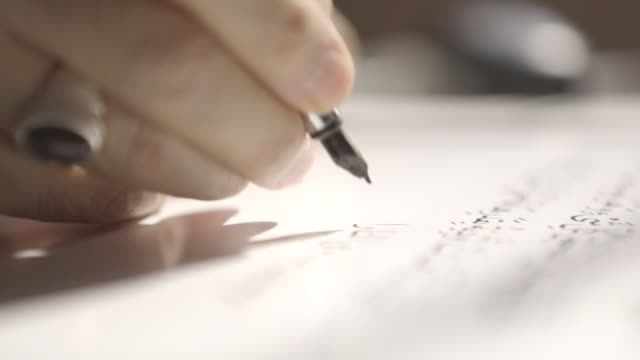 arabic calligraphy rackfocus of the hands of a calligrapher writing with a fountain pen - fountain pen stock videos & royalty-free footage