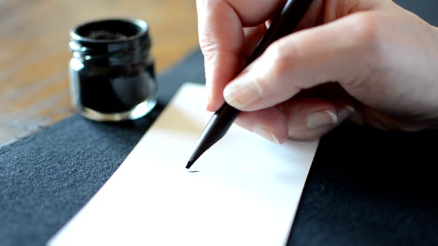 arabic calligraphy: writing the letter meem - arabic script stock videos and b-roll footage
