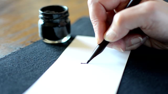 arabic calligraphy: writing the letter noon - pen stock videos & royalty-free footage