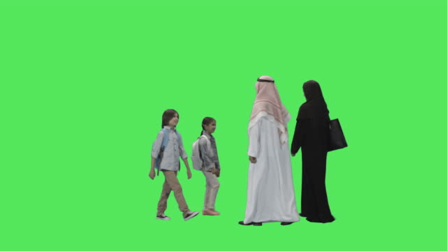 Arabic Family Walking in Traditional clothing