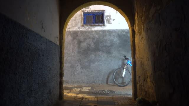 Arabic man passing doorway