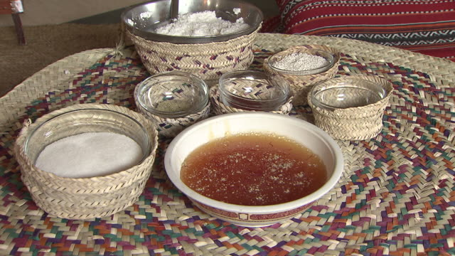 sagaw a bowl of hot sagaw displayed on a woven straw matt in a traditional bedouin tent served as a desert at ramadan - sugar stock videos & royalty-free footage