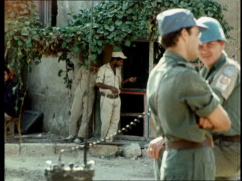 arab/israeli war city suez ms troops pan flag and un troops cs one un solider ms un troops ms egyptians pan un troops ms egyptians sitting jeep lr ms... - 1973 stock-videos und b-roll-filmmaterial